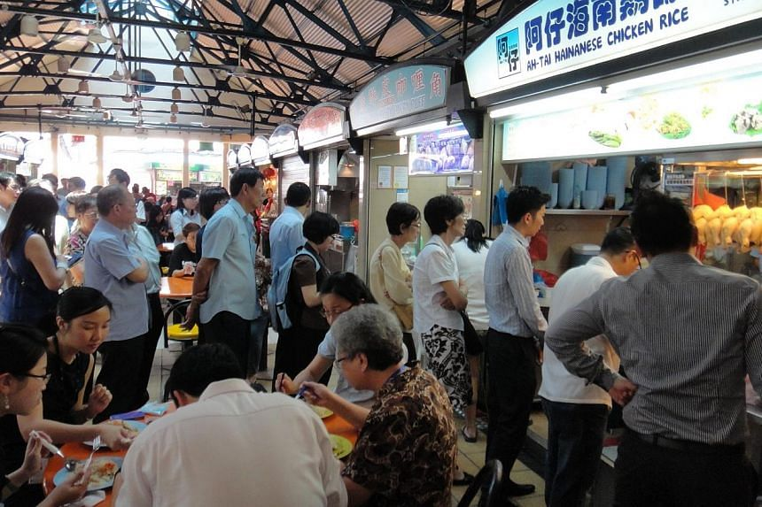 Patrons queueing up at Tian Tian Hainanese Chicken Rice in Maxwell Food Centre during lunch hours on April 26, 2012. PHOTO: ST FILE