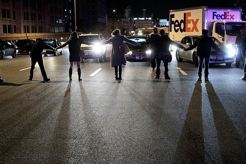Demonstrators block traffic on Highway I-395 during a protest against a New York grand jury decision in Washington, DC. The grand jury decided not to indict police officer Daniel Pantaleo in the death of an unarmed black man, Eric Garner, after putti