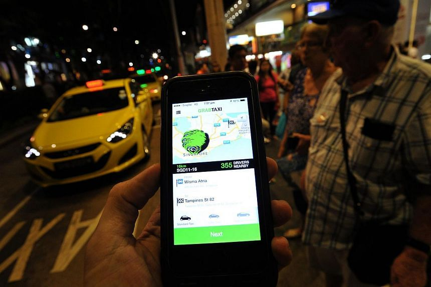 The GrabTaxi app. It allows customers to order cabs closest to their location by mobile phone. -- ST PHOTO: LIM YAOHUI