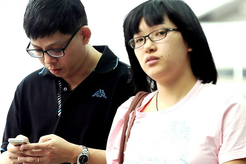 Ong Tiong San with his lover, Ms Zhao Dan. Ong was fined $10,000 after pleading guilty to two counts of forgery. Ms Zhao did not know he had faked their marriage certificate and their child's birth certificate.