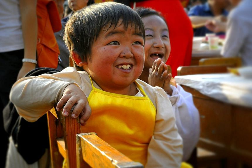 Little People, Big Dreams by film-maker Mak C.K. is based on a dwarf theme park (above) in Yunnan, China.--PHOTO: SINGAPORE INTERNATIONAL FILM FESTIVAL