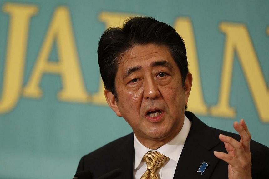 Japan's Prime Minister and leader of the ruling Liberal Democratic Party Shinzo Abe speaks during a debate session with seven other party leaders, ahead of the Dec 14 lower house election, in Tokyo Dec 1, 2014. Abe'scoalition may keep its two-t
