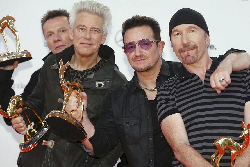 U2 pose with their Music International trophies during the Bambi 2014 media awards ceremony in Berlin Nov 13, 2014. The Irish band, whose last tour in 2009-2011 was the highest-grossing ever, on Wednesday announced concerts in 2015 across North