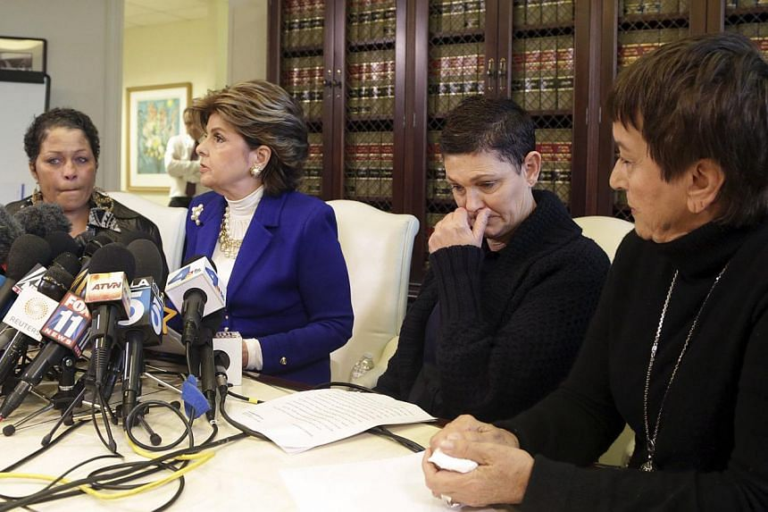A woman who gave her name only as Chelan (left), Beth Ferrier, (second right), Helen Hayes (right) and their attorney Gloria Allred attend a news conference in Los Angeles, California on Dec 3, 2014. The three women came together to speak publicly ab