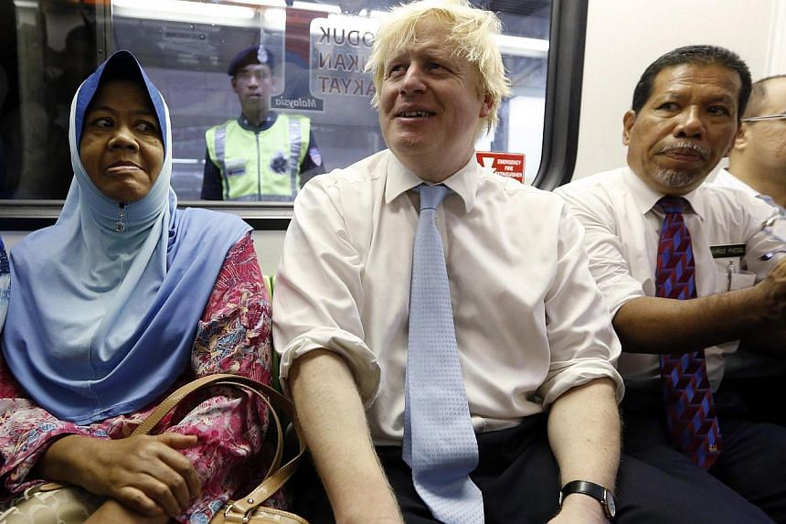 London Mayor Boris Johnson riding the monorail during an official visit to Kuala Lumpur on Dec 1, 2014. On his way home after visiting Malaysia, he was caught up in a mid-air drama when he tried to calm a passenger who became abusive and violent on t