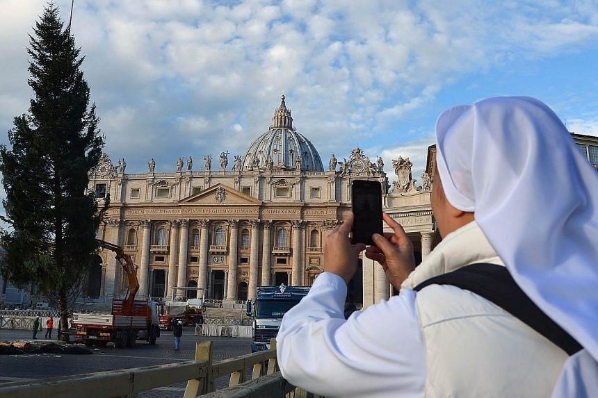 """The Vatican's economy minister has said hundreds of millions of euros were found """"tucked away"""" in accounts of various Holy See departments without having appeared in the city-state's balance sheets. -- PHOTO: AFP"""