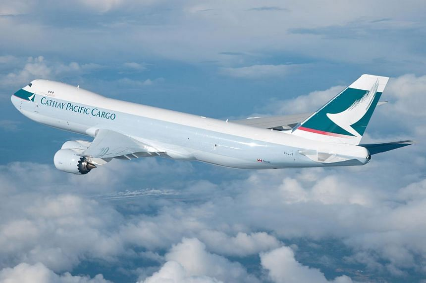 A Cathay Pacific cargo plane. Pilots of the Hong Kong flag carrier were due to start work-to-rule action on Thursday after long-running pay talks broke down, raising the prospect of delays and cancellations in the run-up to Christmas. -- PHOTO: CATHA