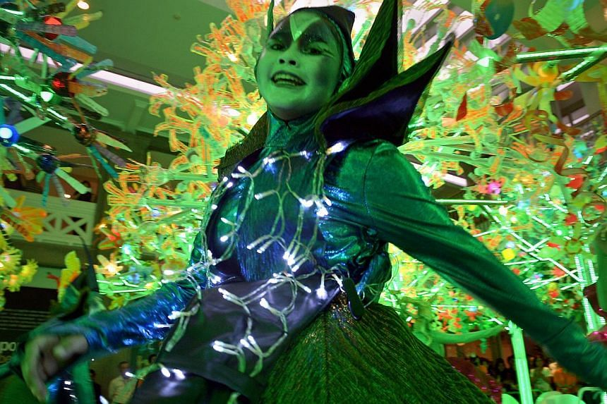 Performers dance around the Singapore Trees of Hope as flower fairies and elves as the plans for Chingay 2015 are announced at the People's Association Headquarters.  --ST PHOTO: KUA CHEE SIONG