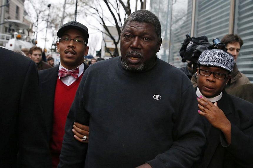 Benjamin Carr (centre), stepfather of Eric Garner, leaves the Staten Island prosecutors office in the Staten Island borough of New York Dec 3, 2014. A New York grand jury has decided not to charge police officer Daniel Pantaleo who killed an unarmed