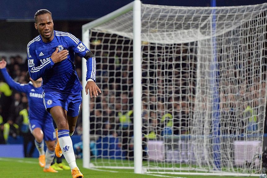 Chelsea's Ivorian striker Didier Drogba celebrates scoring their second goal during the English Premier League football match between Chelsea and Tottenham Hotspur at Stamford Bridge in London on Dec 3, 2014. -- PHOTO: AFP