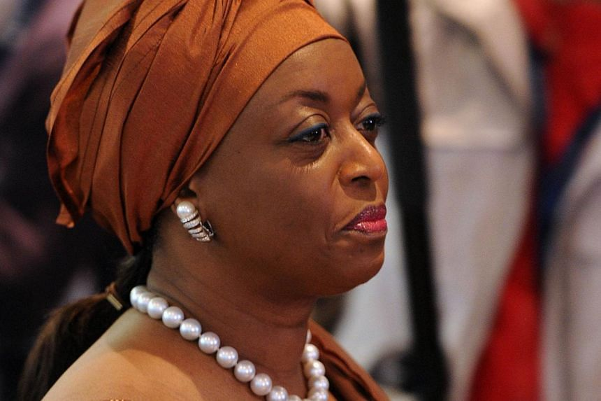 "Opec is facing a challenging time due to the fall in oil prices and many members and non-members are ""suffering immensely"", the cartel's president and Nigeria's oil minister, Diezani Alison-Madueke (above), said Wednesday. -- PHOTO: AFP"