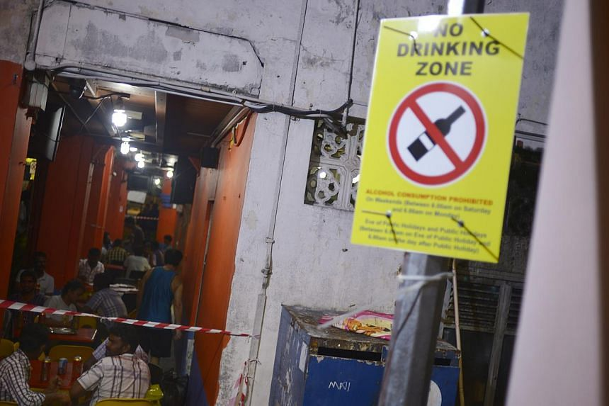 A sign indicating the no drinking zone along kerbau road stands outside a restaurant on Nov 30, 2014. -- PHOTO: ST FILE