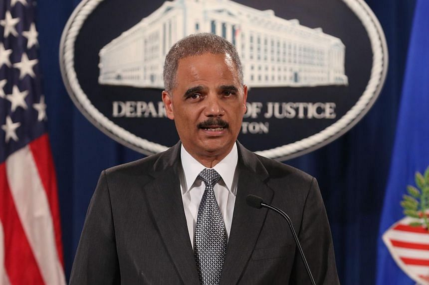 US Attorney General Eric Holder tells reporters that prosecutors will conduct an independent, thorough, fair and expeditious investigation. -- PHOTO: AFP