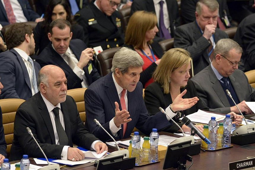 US Secretary of State John Kerry speaks during a round table meeting of the global coalition to counter the Islamic State in Iraq and Syria militant group at Nato headquarters in Brussels Dec 3, 2014. -- PHOTO: REUTERS