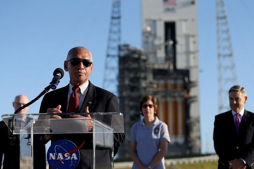 Nasa administrator Charlie Boldenspeaks to the media near the United Launch Alliance Delta 4 rocket carrying Nasa's first Orion deep space exploration craft as it sits on its launch pad on Dec 3, 2014 in Cape Canaveral, Florida. -- PHOTO: AFP