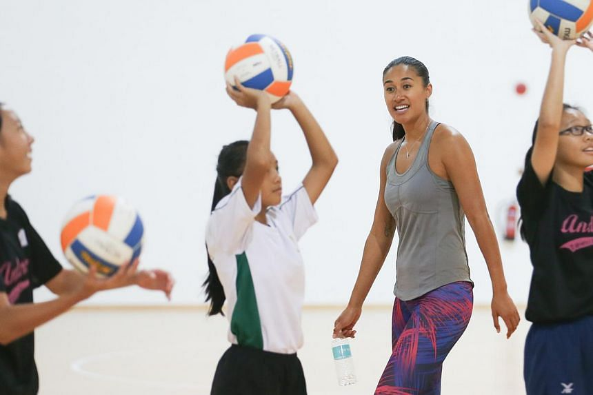New Zealand international netball player Maria Tutaia coaching school players at the OCBC Arena in Singapore on Thursday, Dec 4, 2014. The netball star is in town as part of Nations Cup 2014, where she will speak at a Coaches Seminar and conduct
