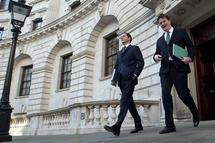 Britain's Chancellor of the Exchequer George Osborne (left) and Chief Secretary to the Treasury Danny Alexander leave the Treasury to present the Autumn Statement to Parliament in London Dec 3, 2014. -- PHOTO: REUTERS