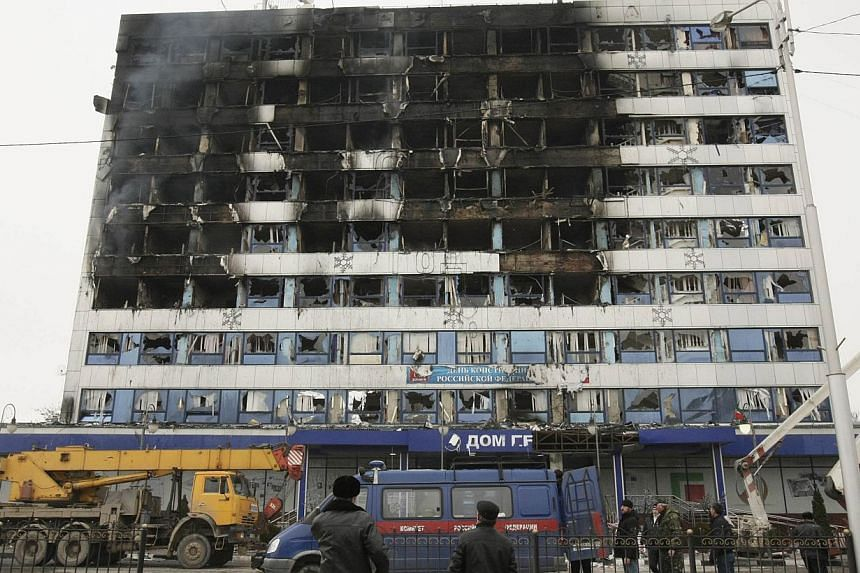 The burnt exterior of the Press House, a local media agency, is seen in the Chechen capital Grozny on Dec 4, 2014. -- PHOTO: REUTERS