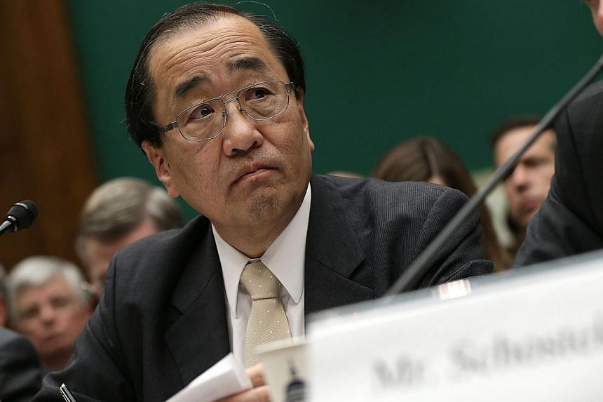 Hiroshi Shimizu, Takata's senior vice-president of global quality assurance, testifies at a Congressional hearing on Dec 3, 2014 in Washington, DC. Shimizuon Wednesday defended the Japanese company's rejection of a nationwide US recall of its p