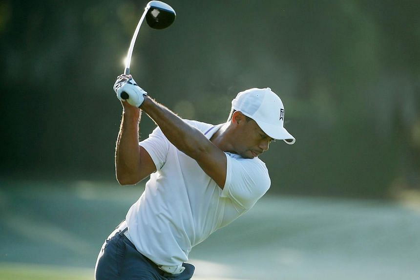 Tiger Woods hits a shot on the practice ground during the pro-am prior to the start of the Hero World Challenge at the Isleworth Golf & Country Club on Dec 3, 2014 in Windermere, Florida. -- PHOTO: AFP