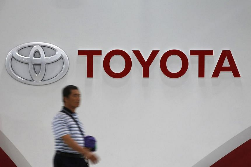 A man walks past Toyota Motor's logo at the company's showroom in Tokyo on Nov 5, 2014.-- PHOTO: REUTERS