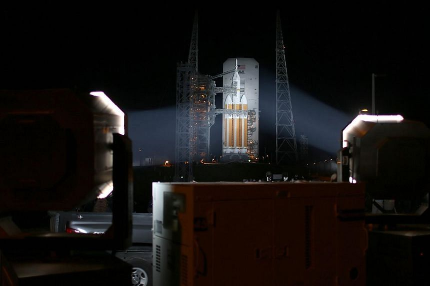 A United Launch Alliance Delta 4 rocket carrying Nasa's first Orion deep space exploration craft sits on its launch pad as it is prepared for its launch on Dec 4, 2014 in Cape Canaveral, Florida. -- PHOTO: AFP