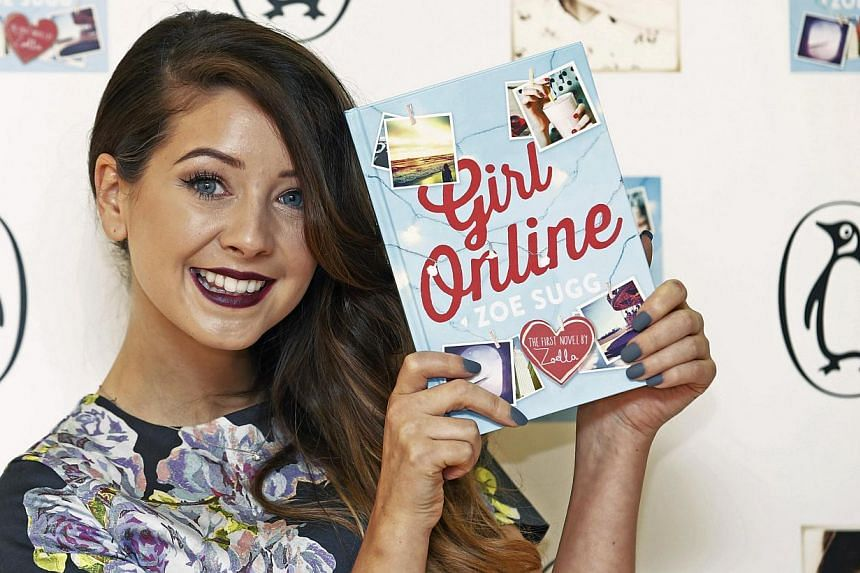 YouTube blogger Zoe Sugg, known as Zoella, poses during a photocall for her debut novel Girl Online in London Nov 24, 2014. Zoella has sold more than 78,000 copies of her first book in a week, beating established authors like JK Rowling and Dan