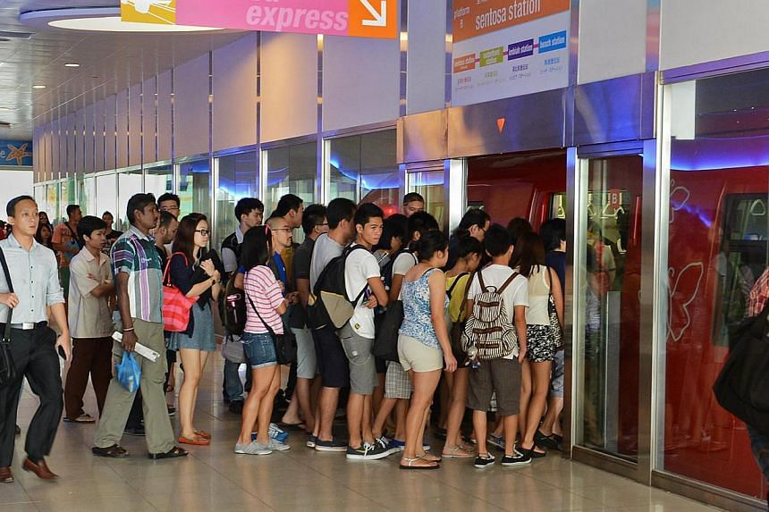 Commuters boarding the Sentosa Express at VivoCity on Nov 2, 2012. Some 61 passengers were stranded in a Sentosa Express train on Thursday night for more than an hour after it stalled. -- PHOTO: ST FILE