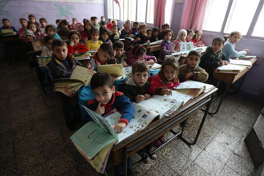 Syrian children at a school in the government-held side of the war-torn northern city of Aleppo on Nov 17, 2014. The Rahmatan Lil Alamin Foundation (RLAF), together with mosques in Singapore, hopes to raise at least $350,000 for a school for children