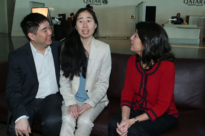 US ambassador to Qatar Dana Shell Smith (right) sits next to freed US couple Grace and Matthew Huang as they wait for their flight at Doha international airport on Dec 3, 2014.-- PHOTO: AFP