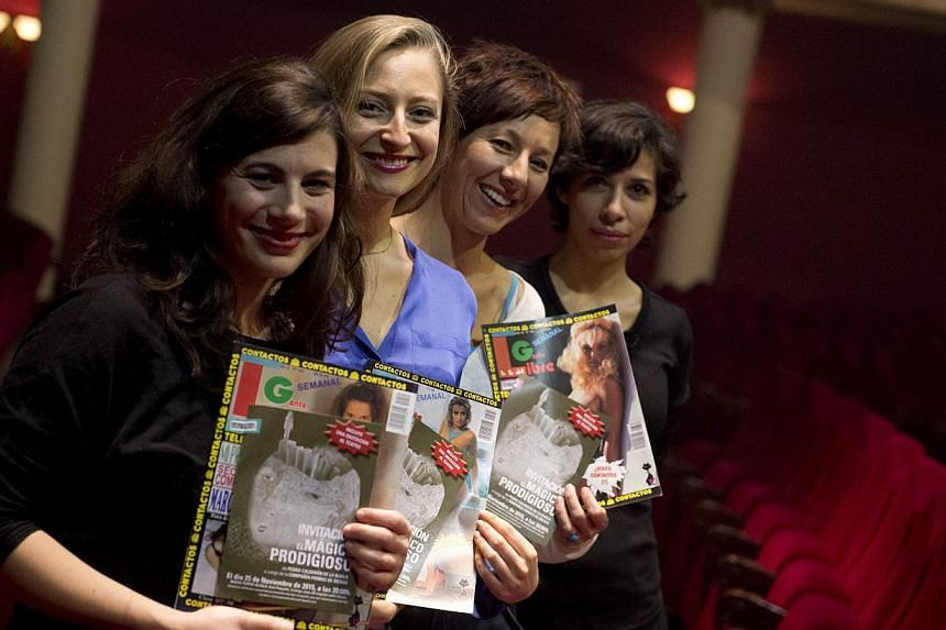 (From left) Actresses Maria Herrero, Paloma de Pablo, Esther Acevedo and Karina Garantiva pose with old pornographic magazines at Nuevo Teatro Alcala in Madrid. The all-women theatre group has found an ingenious way around a sales tax hike that is cr