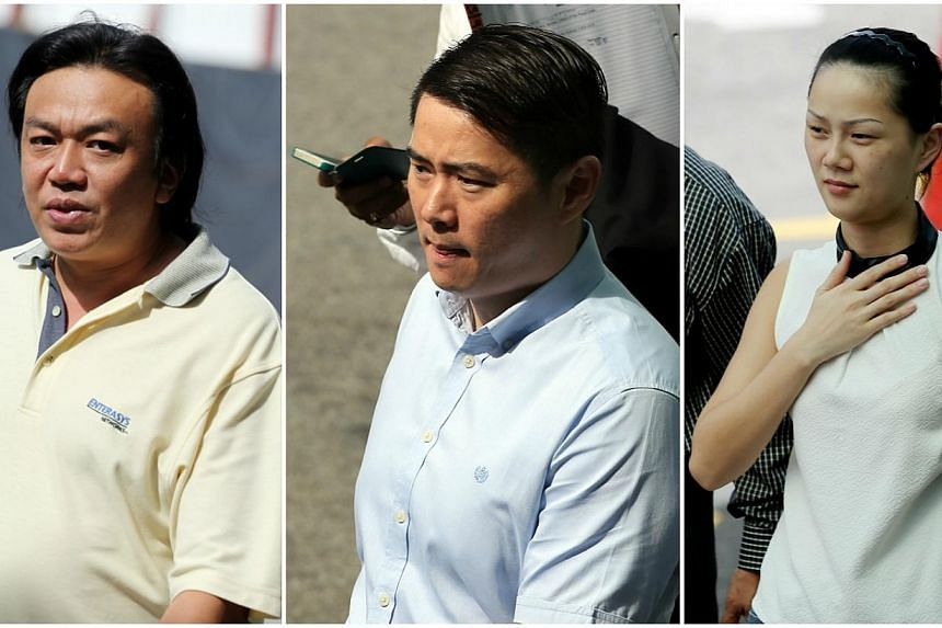 Nineteen people were charged in a district court on Friday with conspiracy to cheat insurance companies in a motor insurance scam. Among them were (from left) Su Chia Ern, who chalked up the most charges, and a couple, Godfrey Liew Kok Hon and his Ch