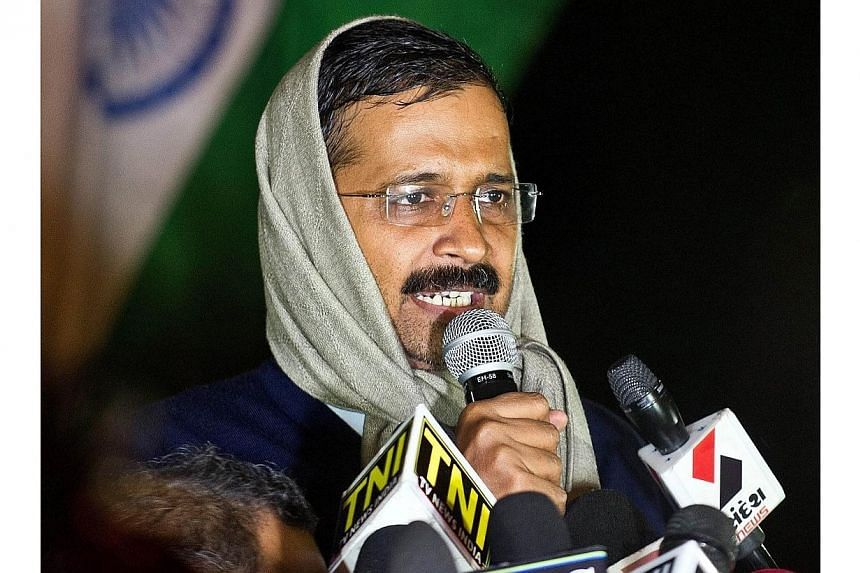 """Delhi's then-chief minister Arvind Kejriwal addresses media at the venue of his sit-in protest in New Delhi on Jan 21, 2014.The leader of India's anti-corruption """"Common Man's Party"""", a long-time scourge of the country's elite, drew widespread"""