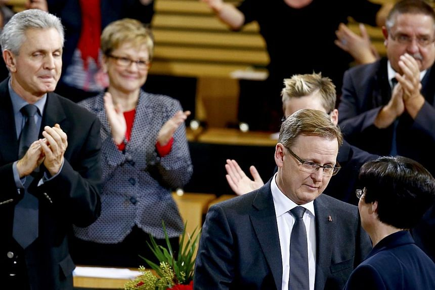 Bodo Ramelow (second right) of the Left party (Die Linke) is congratulated by Christine Lieberknecht, former state premier of Thuringia, after succeeding her, in parliament in Erfurt on Dec 5, 2014.Germany's far-left took the helm of a state as