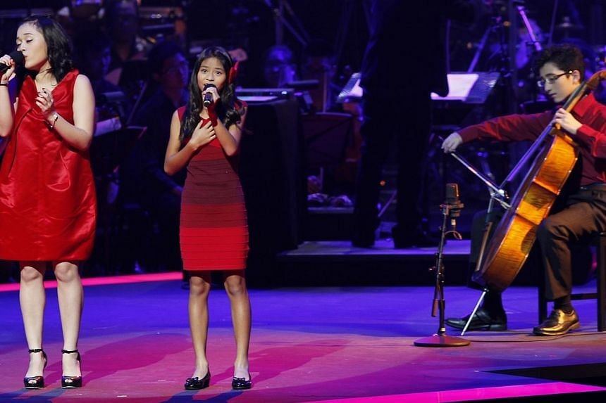 """ChildAid 2014: """" Make You feel My Love"""" Performance by Faith Ng and Micaela Rose Lai with cellist Aoden Teo. -- BT PHOTO: YEN MENG JING"""