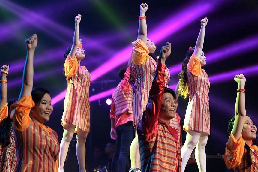 The opening night of the tenth anniversary ChildAid concert held at the Sands Theatre of Marina Bay Sands on Dec 5, 2014. -- ST PHOTO: NEO XIAOBIN
