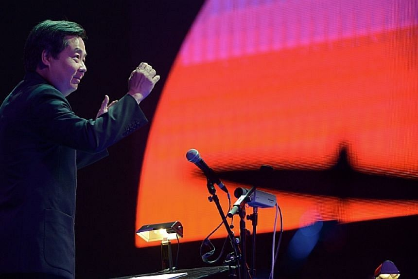 Orchestra conductor Professor Chan Tze Law in action at the ChildAid concert. -- ST PHOTO: DESMOND WEE