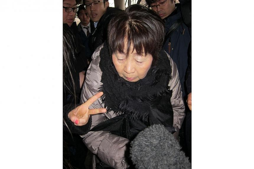 "This file picture taken on March 13, 2014, shows 67-year-old Japanese woman Chisako Kakehi, who was arrested in Kyoto on November 19 on suspicion of poisoning her husband with cyanide in the latest ""Black Widow"" case. -- PHOTO: AFP"