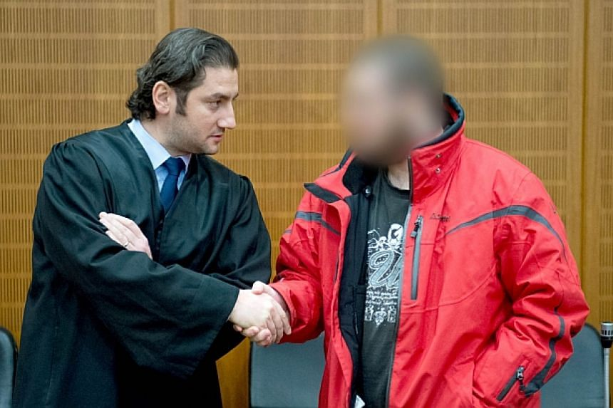 Kreshnik Berisha, 20, a jihadist militant, welcomes his lawyer Mutlu Guenal off the dock in a high-security facilities of the Higher Regional Court in Frankfurt am Main (Hessen).A German court Friday jailed a militant for three years and nine m