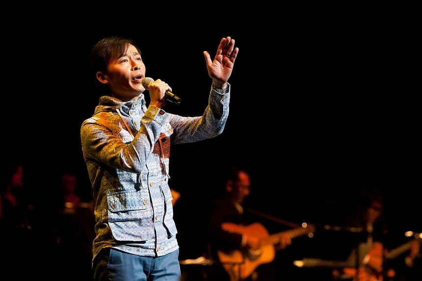 Singer-songwriter Liang Wern Fook performing at a Xinyao Reunion Concert at The Star Theatre. He has never held a concert of his own and will be holding a gig centred on his works at The Star Theatre on April 11, 2015. -- PHOTO:TCR MUSIC STATIO