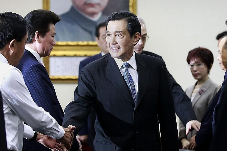 Taiwan President Ma Ying-jeou (centre) shakes hands with Kuomintang (KMT) party officials after announcing his resignation from the party's chairman position during their central standing committee in Taipei on Dec 3, 2014.Taiwan put most of it