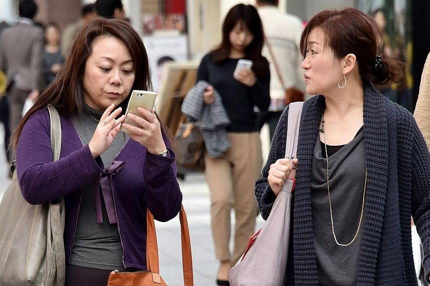 Taiwan has identified 12 smartphone brands that do not conform with privacy standards, and the handset makers could face fines or a ban unless they address the breaches, an official at the telecoms regulator said on Friday. -- PHOTO: AFP