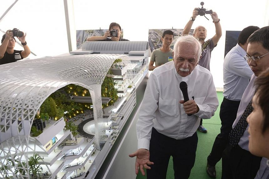 Transport Minister Lui Tuck Yew (right) and lead design consultant Moshe Safdie (centre), take a look at a life-size model of Jewel Changi Airport, the mixed-use complex featuring attractions, retail offerings,a hotel and facilities for airport opera