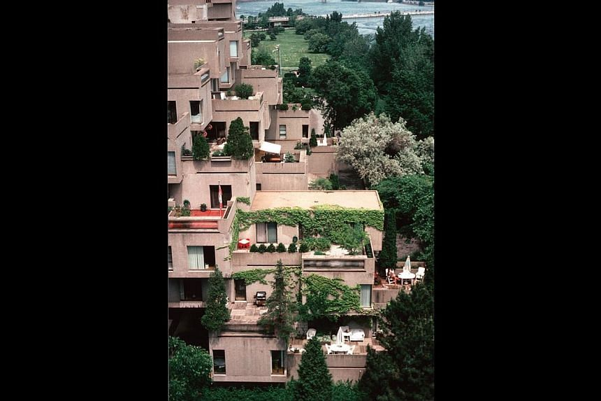 Habitat 67 in Montreal, Canada was designed by Moshe Safdie between 1964 and 1967. Box-like concrete residential units stacked in a seemingly random way to create interspersed crannies which inhabitants can use as calming, private nooks. -- PHOTO: MO