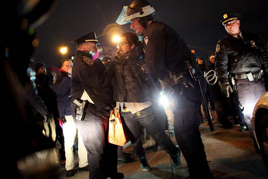 Police arrest a man on the West Side Highway during a protest against police killings of black suspects on Dec 4, 2014 in New York. -- PHOTO: AFP