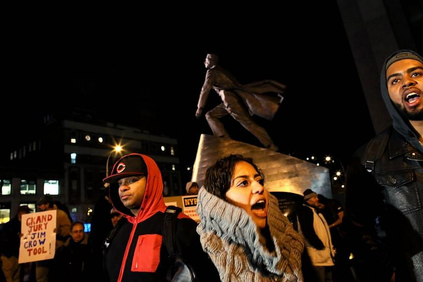 People gather in front of the Adam Clayton Powell Jr. State Office Building during a protest against police killings of black suspects on  Dec 4, 2014 in New York.  -- PHOTO: AFP