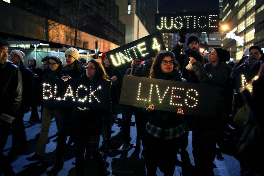 Marchers approach the West Side Highway during a protest a protest against police killings of black suspects on Dec 4, 2014 in New York. -- PHOTO: AFP