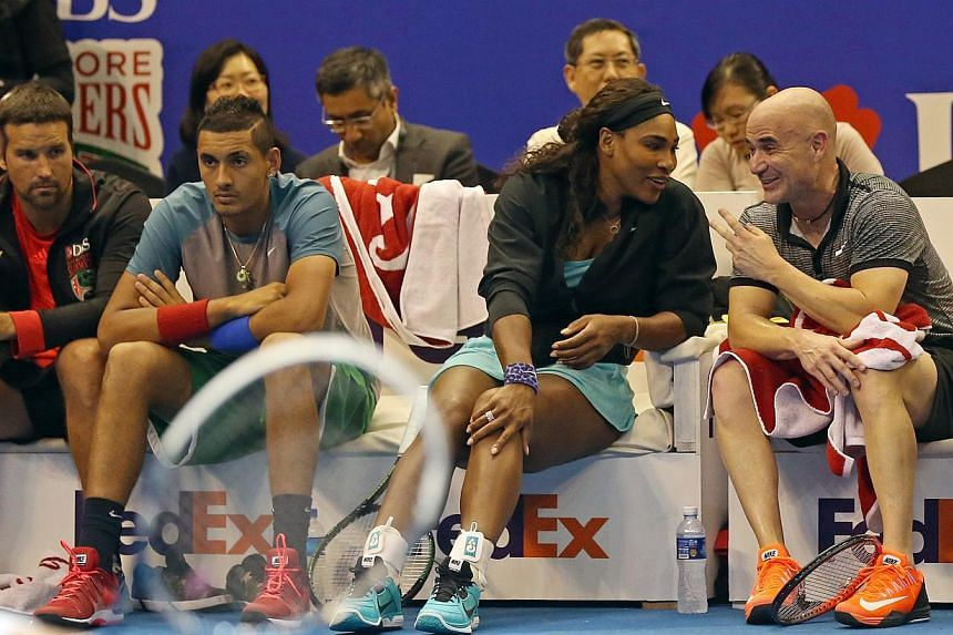 Tennis star Serena Williams and legend Andre Agassi chatting on the sidelines at the opening day of the Singapore leg of the International Premier Tennis League on Dec 2, 2014.Agassi said he was embarrassed at his cameo on Thursday after he was