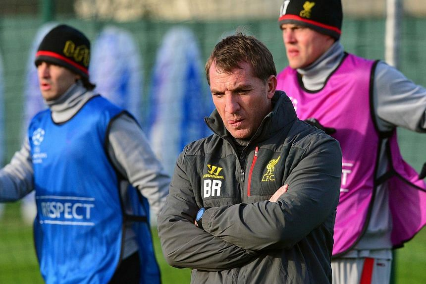 Liverpool manager Brendan Rodgers (foreground) supervises a training session at their Melwood training ground on Nov 25, 2014. Rodgers was given a vote of confidence on Thursday by the club's chief executive Ian Ayre, who dismissed recent speculation