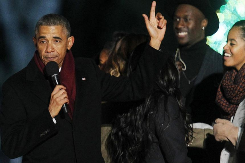 US President Barack Obama waves to the audience during the 92nd annual National Christmas Tree Lighting on the Ellipse near the White House in Washington, DC on Dec 4, 2014. -- PHOTO: REUTERS